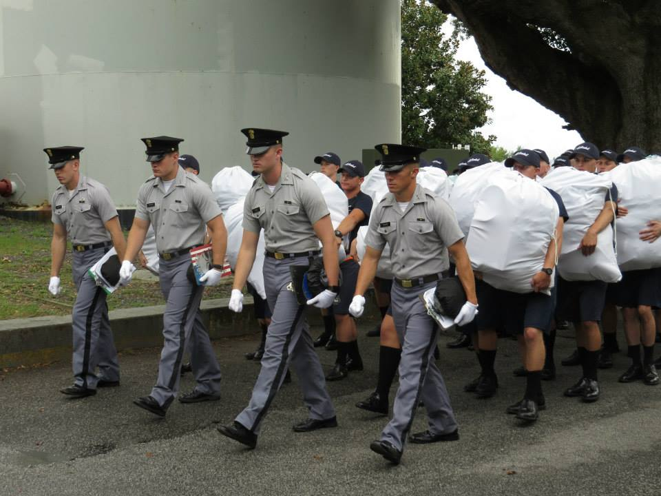 Cadre members lead knobs from the Cadet Store back to their company. August 2015